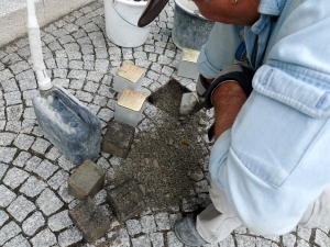 Each stolperstein replaces a cobblestone in the sidewalk in front of the residence