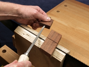 advance the fleam angle guide as you progress down the blade, filing every other tooth (the ones that are facing away from you). turn the saw around and repeat for the rest of the teeth.